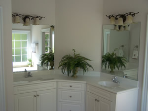 spacious master bath with his and hers vanities